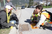 Trafalgar students painted messages near storm drains throughout Uphill Monday as part of Earth Day.  Bruce Fuhr photos